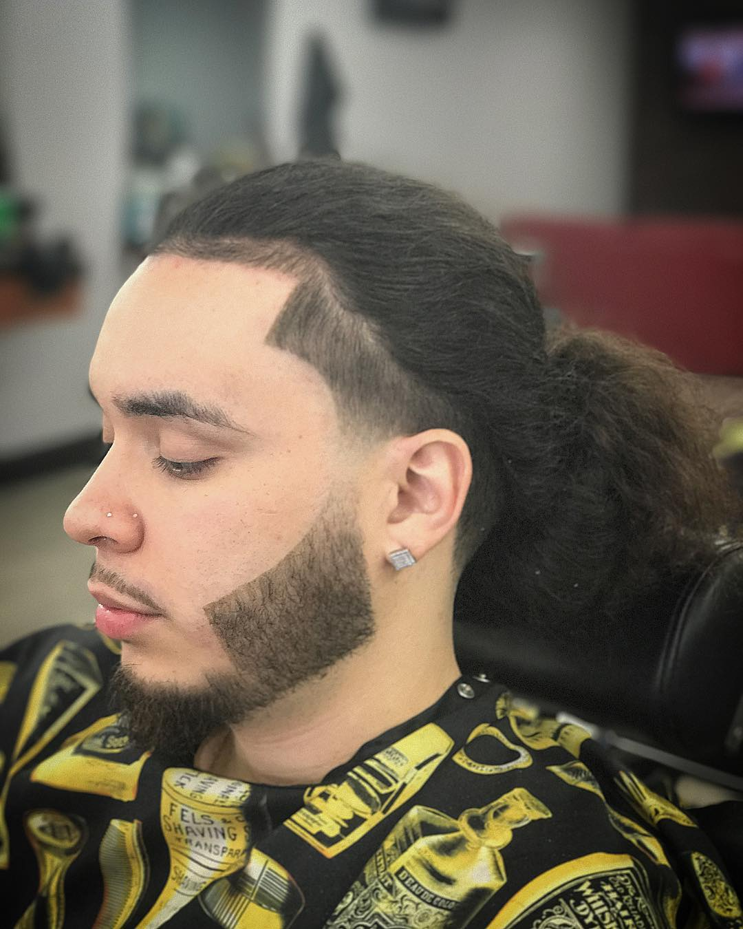 Long curly hair hairstyle for men with low fade